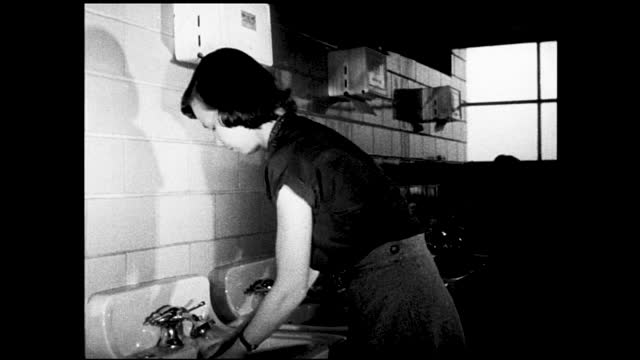 two women entering the locker room and smiling, one hangs her coat inside a locker; woman washing and drying her hands inside the bathroom - 1940 1949 stock videos & royalty-free footage