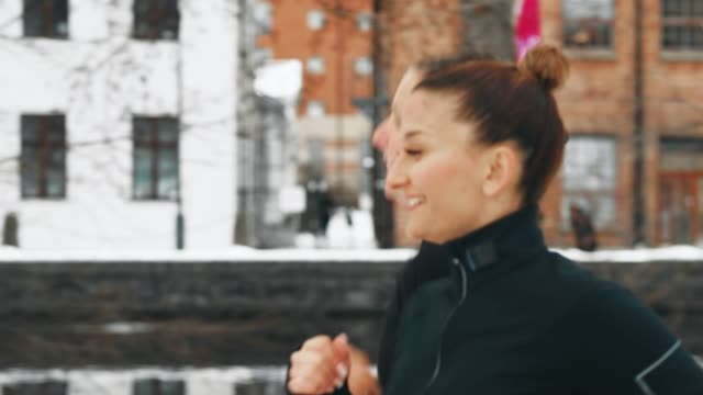 Two women exercising out in the snow