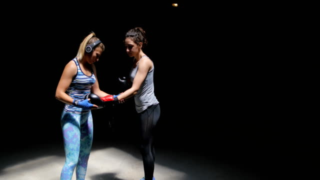 two women friends to pull boxing gloves - strongwoman stock videos & royalty-free footage