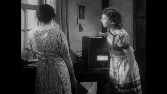 montage two women greet visitors to their home / east anglia, united kingdom - anno 1940 video stock e b–roll