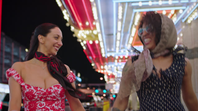 two women hold hands and run through downtown las vegas. - ladies' night stock videos and b-roll footage