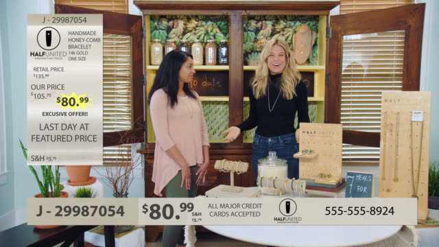 stockvideo's en b-roll-footage met two women hosting infomercial display and discuss jewelry and accessories. - televisiereclame