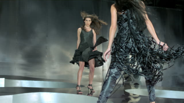 two women in a fashion showdown. - runway stock videos & royalty-free footage