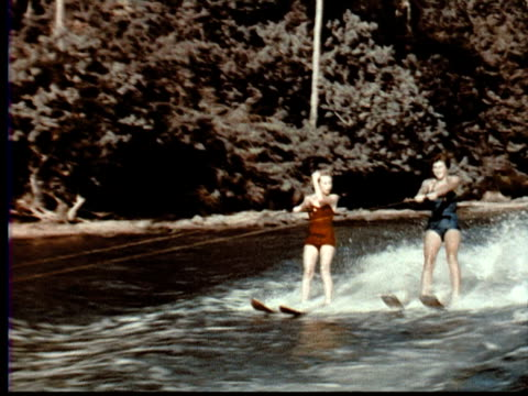 1957 ws two women in bathing suits water skiing. jungle in background / singapore / audio - 1957 stock videos & royalty-free footage