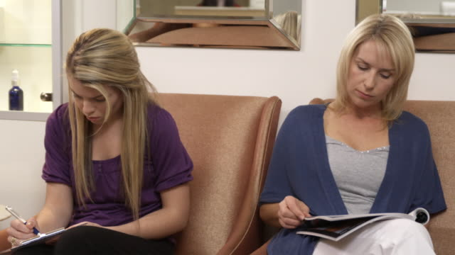MS, Two women in clinic waiting room, Sydney, Australia
