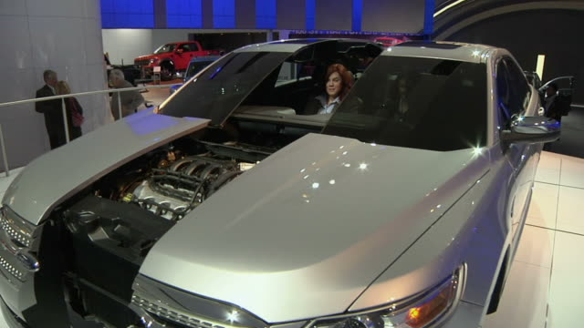 ms two women in ford electric vehicle on display at detroit auto show, detroit, michigan, usa - ford motor company stock videos & royalty-free footage