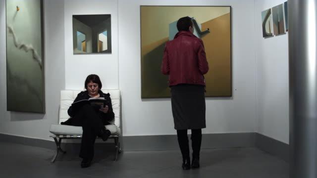 ws two women in gallery space / bilbao, vizcaya, spain. - art gallery stock videos & royalty-free footage