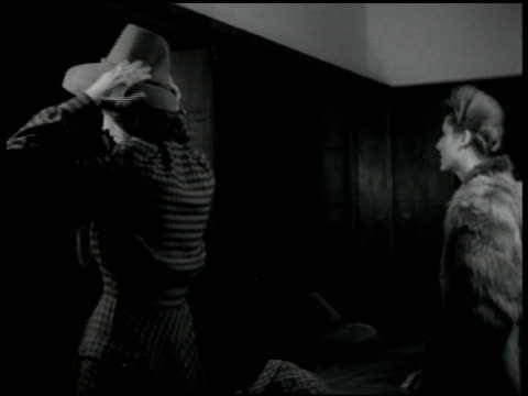 dramatization two women in shop one trying on hat other looking at dress ms female hands placing cash paper money reichmarks bank notes on shop table... - 1947 stock-videos und b-roll-filmmaterial