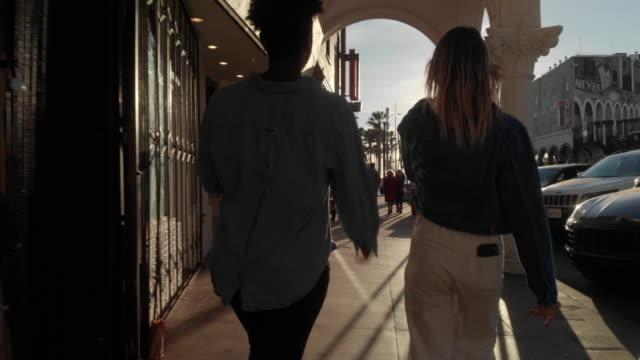two women in venice beach, california - twilight stock videos & royalty-free footage