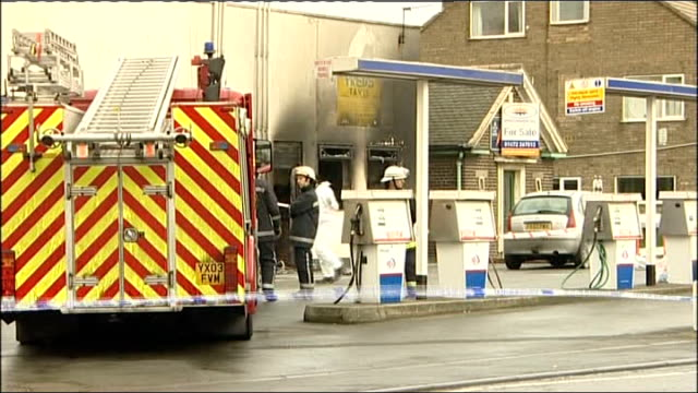 two women killed in taxi office fire england lincolnshire immingham ext firefighters and forensic investigators at scene of burnedout 'fred's taxis'... - 自動車ブランド mini点の映像素材/bロール