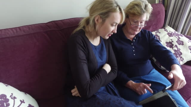 Two women looking at a tablet computer