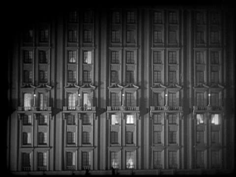 ms, cu, b&w, two women looking at building with lights on and off, 1920's  - anno 1928 video stock e b–roll