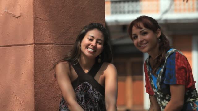 MS Two women looking at camera and smiling, Merida, Yucatan, Mexico