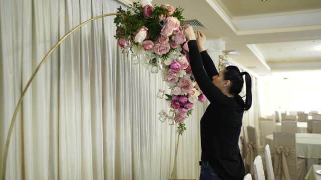two women making wedding decor at restaurant - arranging stock videos & royalty-free footage