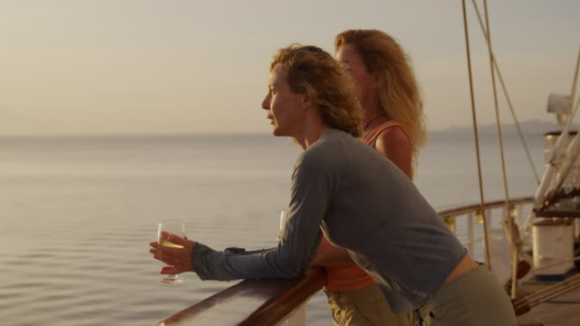 two women on a yacht having a glass of wine - 45 49 jahre stock-videos und b-roll-filmmaterial
