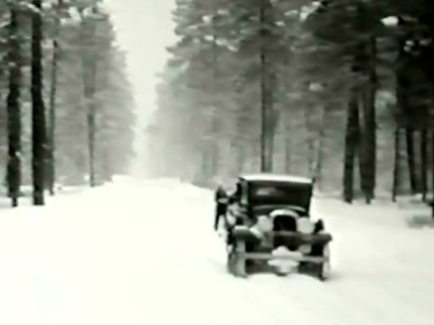 ws pan two women on skis towed behind car / long beach, california, usa - horseless carriage stock videos & royalty-free footage