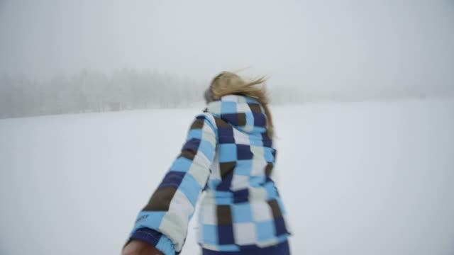 two women playing in snow - skijacke stock-videos und b-roll-filmmaterial