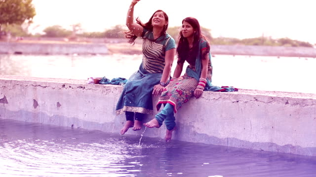 Two women playing with water