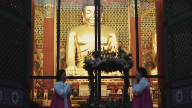ms two women praying in front of jogyesa temple, buddha's birthday, seoul, south korea - buddha's birthday stock videos and b-roll footage