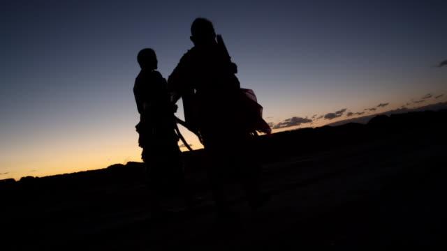 two women prepare for navajo ceremony at sundown - navajo culture stock videos & royalty-free footage