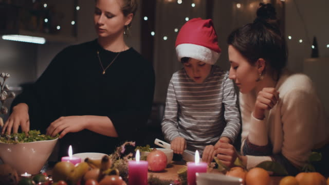 two women preparing christmas dinner with young boy - godmother stock videos & royalty-free footage