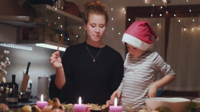 two women preparing christmas dinner with young boy - arbeitsplatte stock-videos und b-roll-filmmaterial