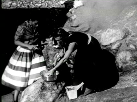 stockvideo's en b-roll-footage met b/w pan  two women preparing to make spaghetti over hot spring, naples, italy / audio - dragen