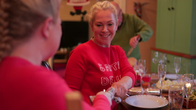 two women pulling the cracker open at christmas - cracker stock videos and b-roll footage