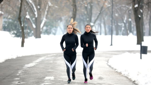 two women running - morning exercise stock videos & royalty-free footage