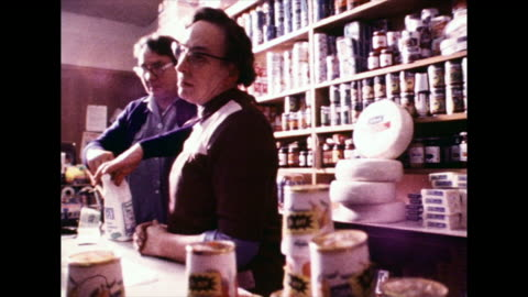 two women serve customers in village shop; 1972 - 1972 stock videos & royalty-free footage