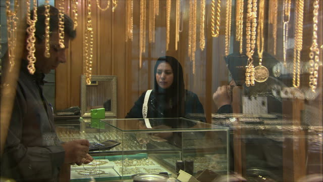 CU Two women shopping at jewelry store in Grand Bazaar, Isfahan, Iran
