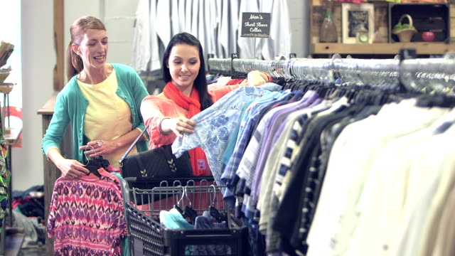 two women shopping in a clothing store - second hand stock videos & royalty-free footage