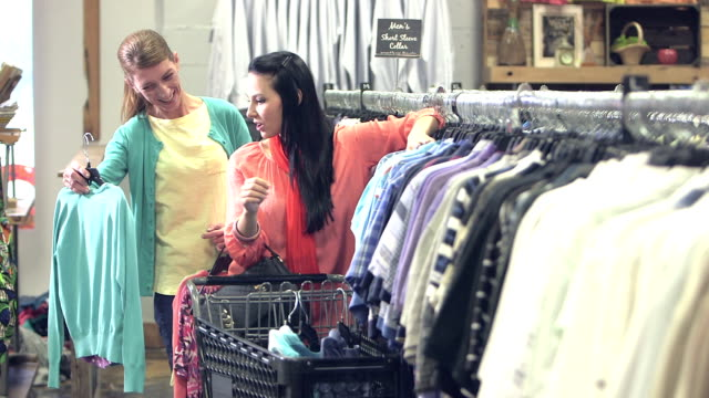 Two women shopping in a clothing store