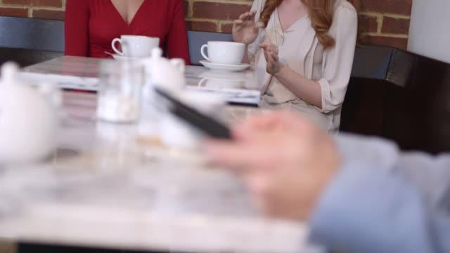 Two women sitting in café