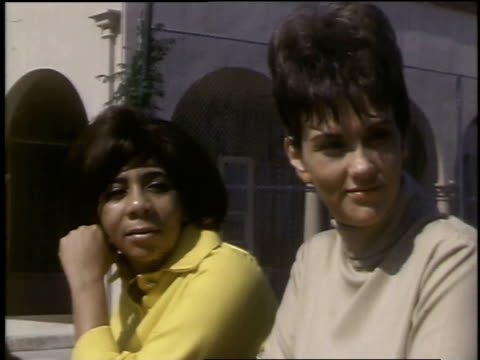 1968 montage two women sitting next to each other then a man and a woman sitting next to each other - anno 1968 video stock e b–roll