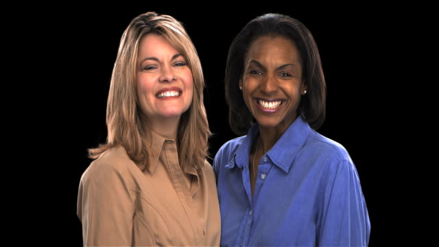 two women smiling - this clip has an embedded alpha-channel - keyable stock videos & royalty-free footage