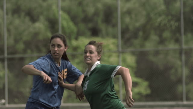slo mo ms two women soccer players jumping up to head soccer ball on field at biola university / la mirada, california, usa - geköpft stock-videos und b-roll-filmmaterial