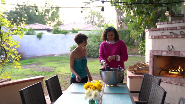 two women stocking a cooler of beer - arranging stock videos & royalty-free footage