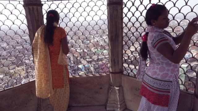 Two women taking pictures of New Delhi from Friday Mosque, India