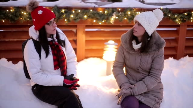 Two women talking.Winter vacation at the mountain