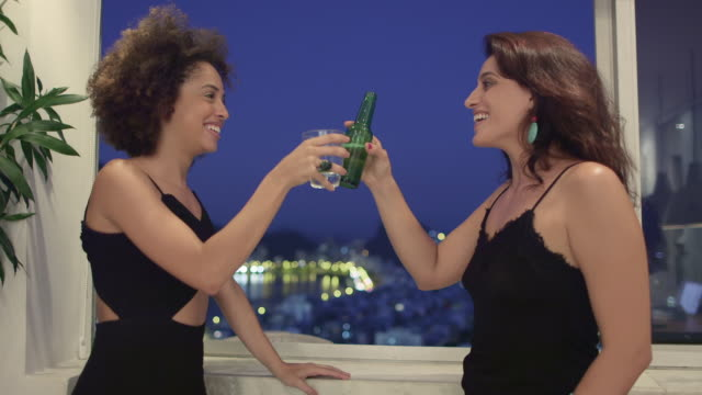 ms two women toast and have a drink together / rio de janeiro, brazil - pardo brazilian stock videos & royalty-free footage
