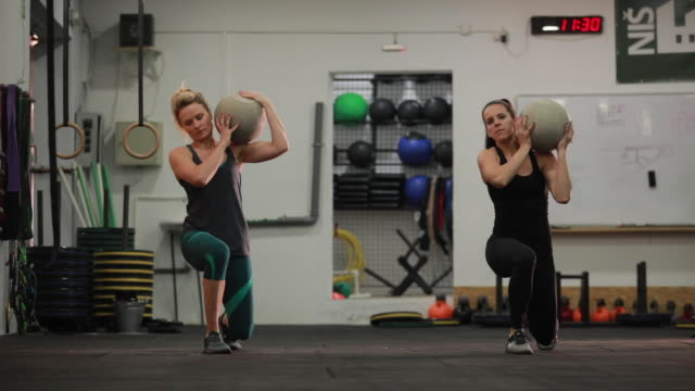 two women training in gym - cross training stock videos & royalty-free footage