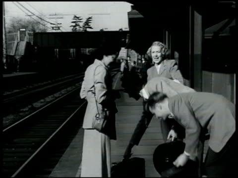 traveling dramatization two women w/ two men on outdoor train station platform women talking men talking train arriving men helping women onto train... - 1949 stock videos and b-roll footage