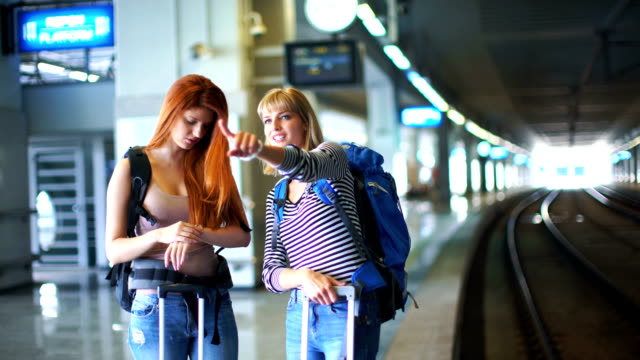 two women waiting for a train. - railway station stock videos and b-roll footage