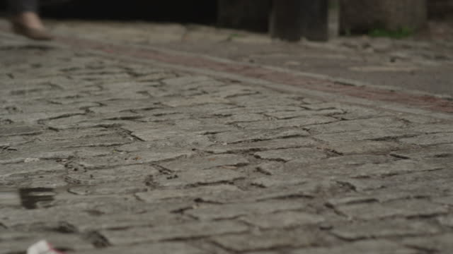 two women walk along an uneven brick road. - uneven stock videos & royalty-free footage