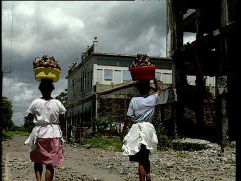 two women walk down road carrying heavy buckets on their heads nicaragua - nicaragua stock videos & royalty-free footage