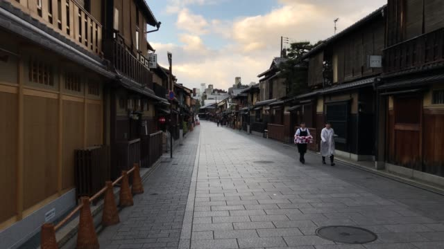 two women walk in an empty street on april 24, 2020 in kyoto, japan. foreign visitor numbers to japan have fallen by 99.9 per cent on last year as... - kyoto prefecture stock videos & royalty-free footage