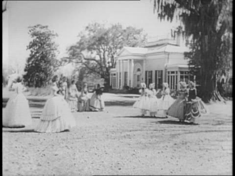 two women walk into a building bearing the sign 'pilgrimage garden club headquarters' / montage of people dressed in antebellum costume on the... - the machine: master or slave stock videos & royalty-free footage