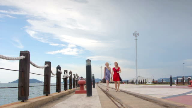Two Women Walking along a Marina, Sabah