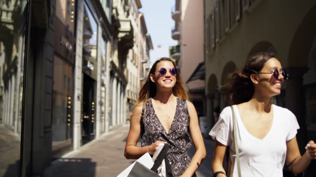 two women walking along a street after shopping - switzerland stock videos & royalty-free footage